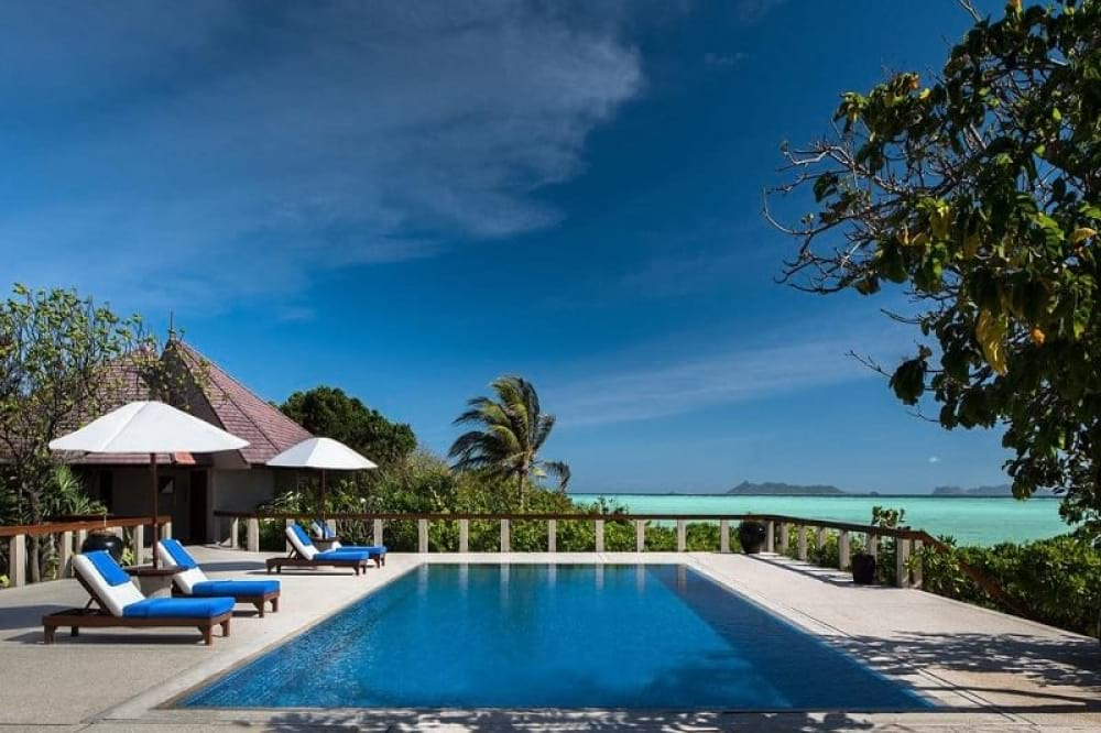 Amanpulo Resort package by The Luxe Guide